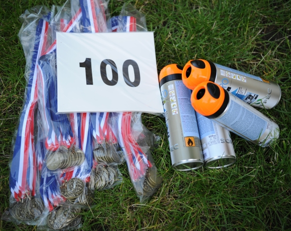 Medals, numbers and marking paint.